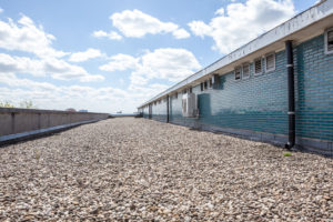 Roof Coatings And Gravel For Commercial Roofing