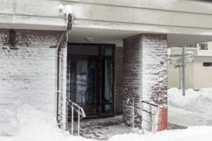 snow covered commercial building roofing